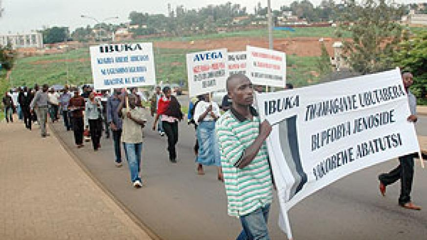 MAKING THE LONG WALK: Demonstrators making their way to the the ICTR Offices in Remera yesterday. (Photo J. Mbanda)