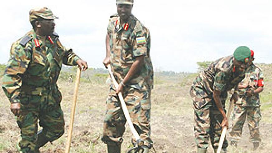 RDF Generals James Kabarebe (R), Charles Kayonga and Charles Muhire during the launch of the cassava planting project in Bugesera District.