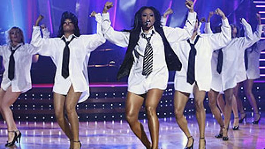 Ciara and her dance crew go shirt and ties only during a concert.