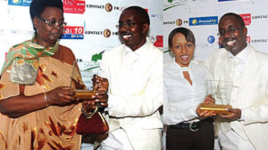 L-R : Renowned singer Florida Uwera receives an award;All smiles. TVR news anchor, Evelyn Umurerwa received an award for promoting local music and artists. Looking on is the event's organiser Aimable Kubana.(photos by F.H Goodman)