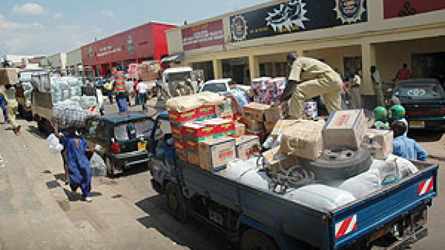 DOWNTOWN DURING DAY: Goods being offloaded in Matheus street, one of the busiest streets during day. Such places are dead at night. (File Photo)