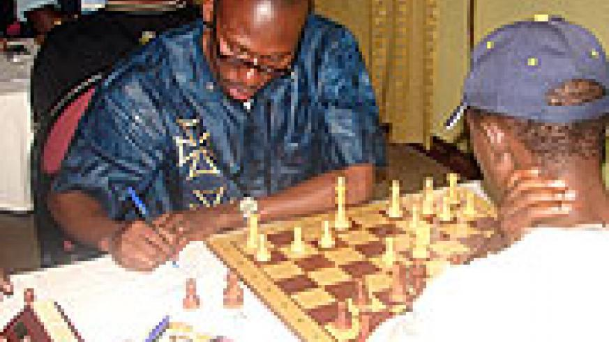 Abiye (R) playing against a Uganda player.
