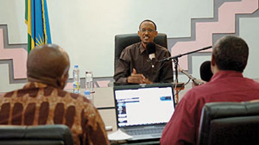 President Paul Kagame responding to questions from panelists during yesterday's live Radio talk show.  (Photo/ Urugwiro Village)