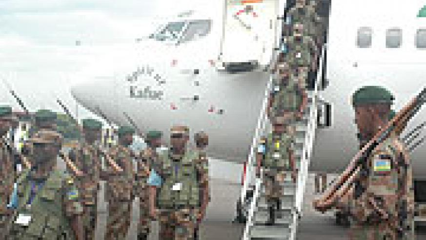 Members of the RDF disembarking the plane at the airport yesterday upon thier return from the EASBRIG joint military exercise in Djibouti. (Photo/ F.Goodman)