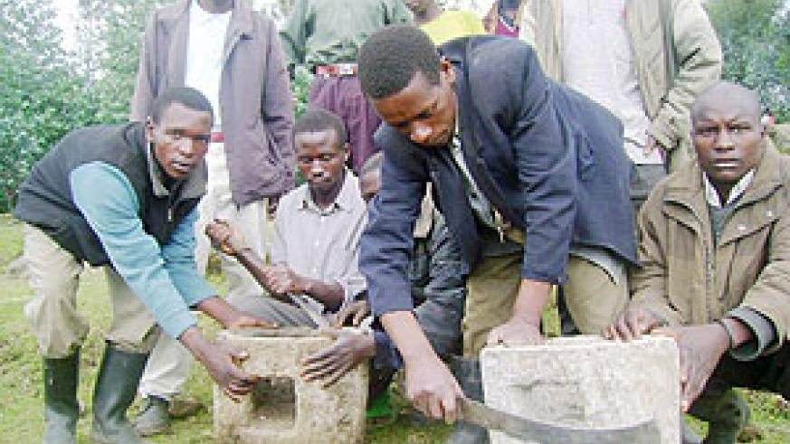 Residents demonstrate their stoves made out of Volcanic Larva. (Photo: B. Mukombozi)