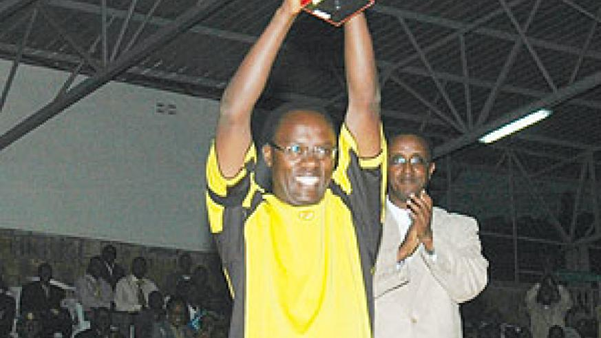 The Governor of Southern Province, Fidele Ndaysaba, lifts the trophy after his province won the Good Governance soccer tournament held at the end of the 7th National Dialogue. Looking on is the Senate president, Dr Vincent Biruta.