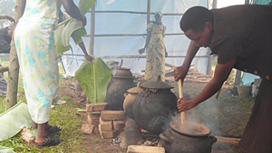 A participant in the mobile museum programme prepares a millet flour meal in a traditional pot. (Photo / P. Ntambara)