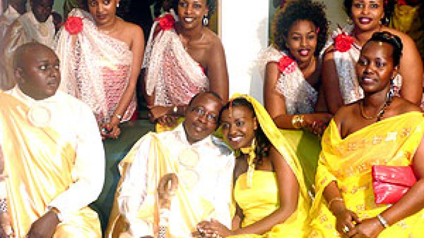 Miss Tonzi and her fiancé Alfred Gatarayiha (centre) look wonderful with the maids.