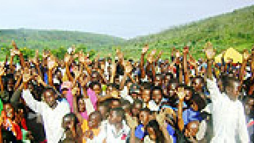 Residents of Rwagitima sector in Gatsibo district raise their hands up to say they will register for 2010 elections. (Photo: S. Rwembeho)