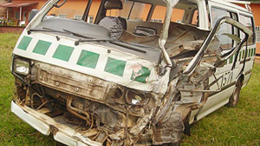 NARROW ESCAPE:  The wreckage of the commuter taxi in which 15 people sustained injuries in an accident on the Kigali-Huye route. (Photo/P. Ntambara)