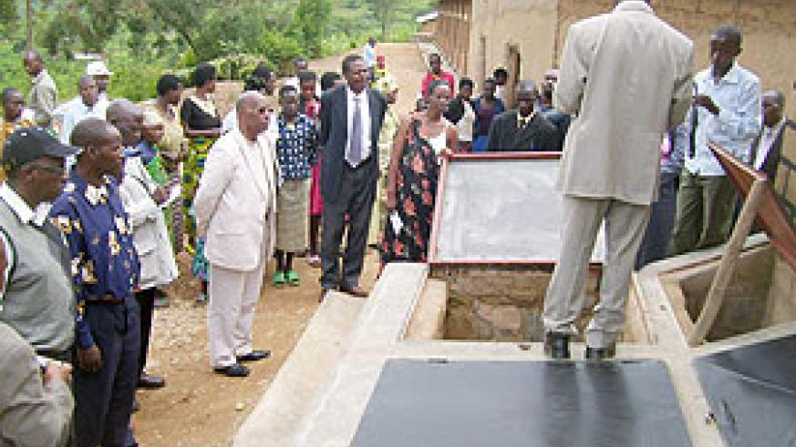 An official of Rwanda environment care explains how ecological toilets work during the launching ceremony at Karambo B primary School on Thursday. (Photo: A. Gahene)