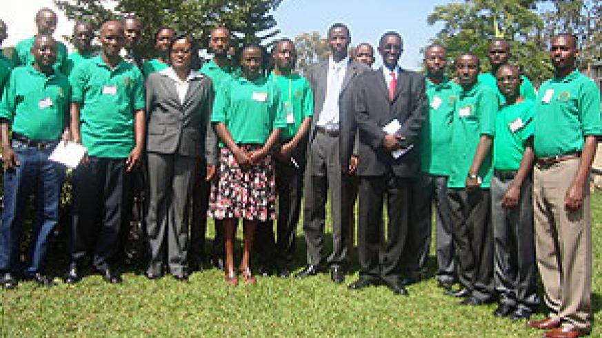 EAC Minister Monique Mukaruliza in a group photo with EACSU committee members. (Photo. I. Niyonshuti)