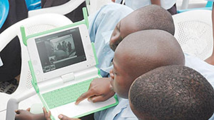 Kagugu Primary School boys use wireless Internet off their laptops. (File Photo)