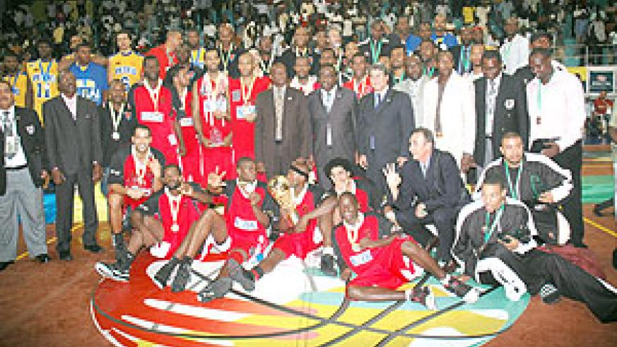 Sports Minister Joseph Habineza (standing centre), FIBA officials as well as players of the three top teams; Primeiro, Petro Atletico and APR enjoy a group photo after the closing ceremony. (Photo / F. Goodman)