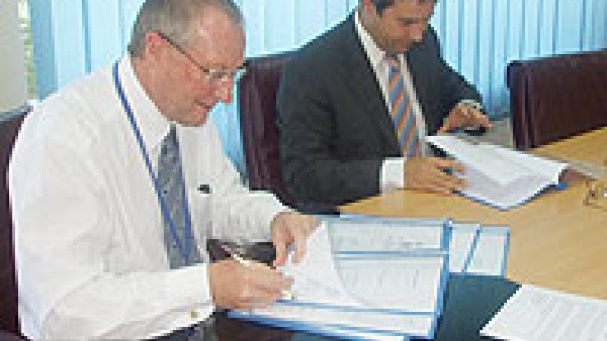 FINA Bank's Managing Director Steve  Caley Left and Stephan Klingebiel KfW's Director Office Kigali during the signing ceremony. (Courtesy Photo)