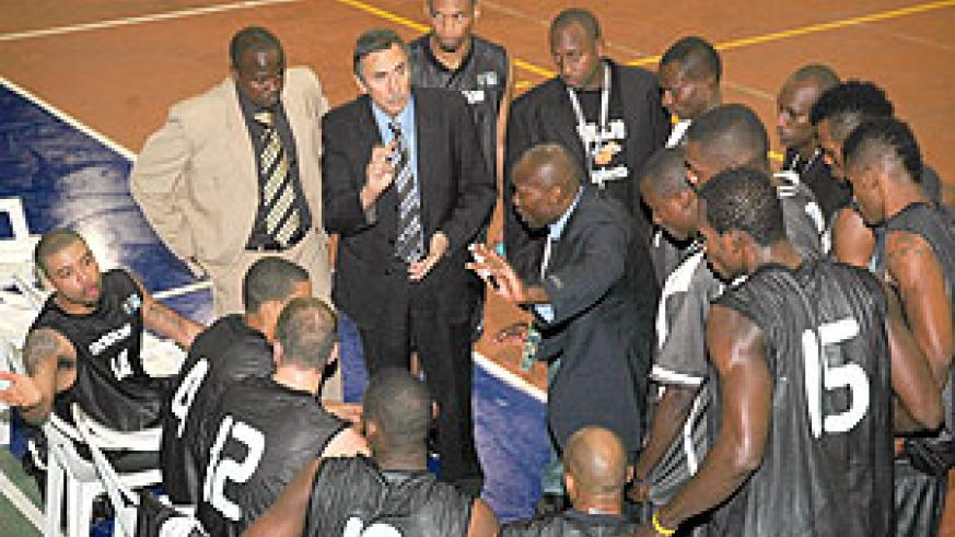 APR's coach Cliff Owour (C) giving his players instructions during the just concluded Fiba Africa Club Championship where the Rwandan champions finished third.