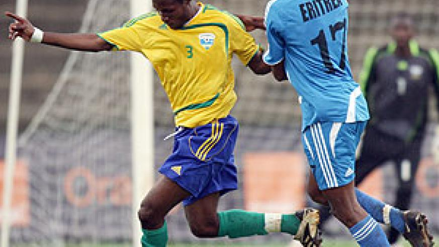 Kalisa Mao (left) battles against Isaias Andeberhian of Eritrea during the 2009 Cecafa Senior Challenge Cup in Nairobi. But the APR defender has been left out of the new squad due to a broken arm.