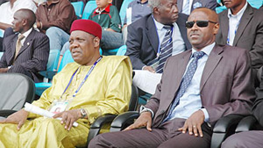 CAF president Issa Hayatou (L) hailed Rwanda for hosting a memorable championship. On the right is Ferwafa boss Brig. Gen Jean Kazura, who is seeking a second term of office. (File photo)