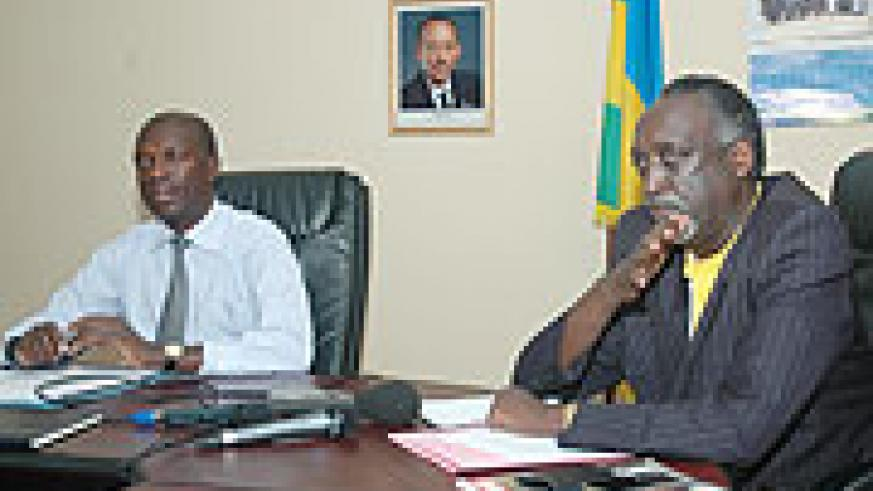 Ombudsman Tito Rutaremara(R) making the announcement to the media recently as the Minister of Labour and Public Service, Anastase Murekezi looks on (File photo)