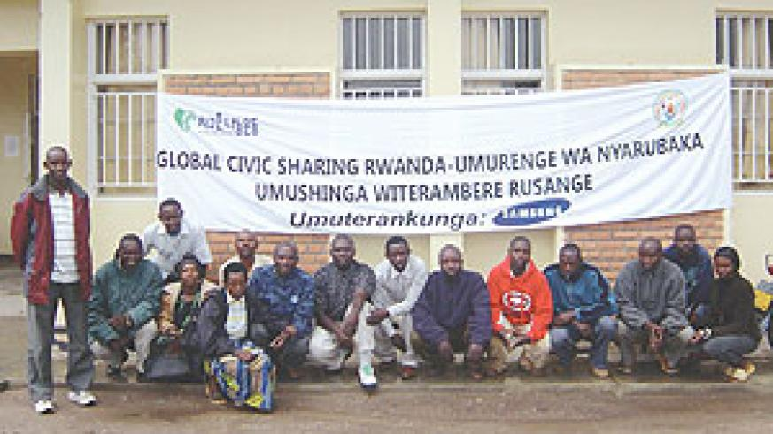 BENEFITED: Some of the projects' beneficiaries in a group photo.(Photo/M. Gahigi)
