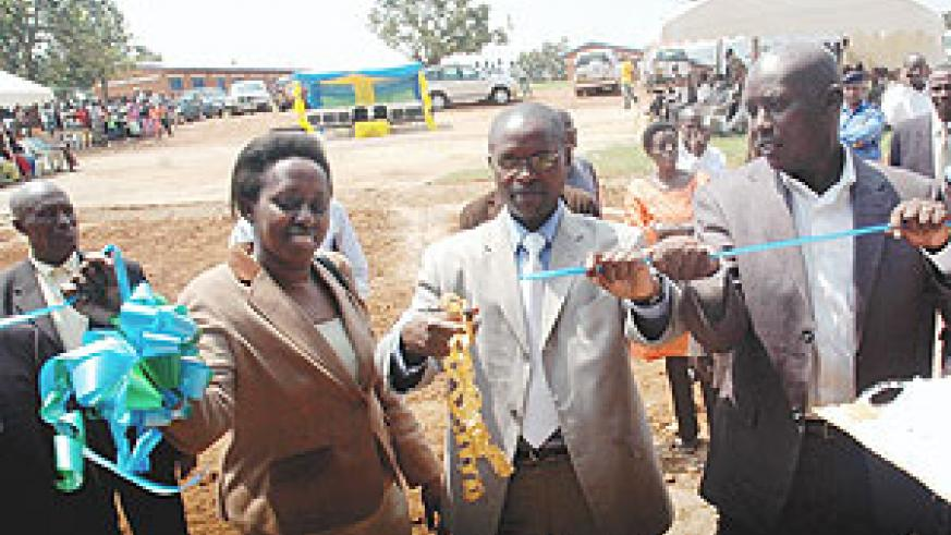 State Minister for Primary and secondary Education ( c ), Mathias Harebamungu , Kigali City Mayor Aisa Kirabo and Kicukiro District Mayor Paul Jules Ndamage  officially open classrooms for the nine year basic education in Kicukiro District. (Photo/ J. Mba
