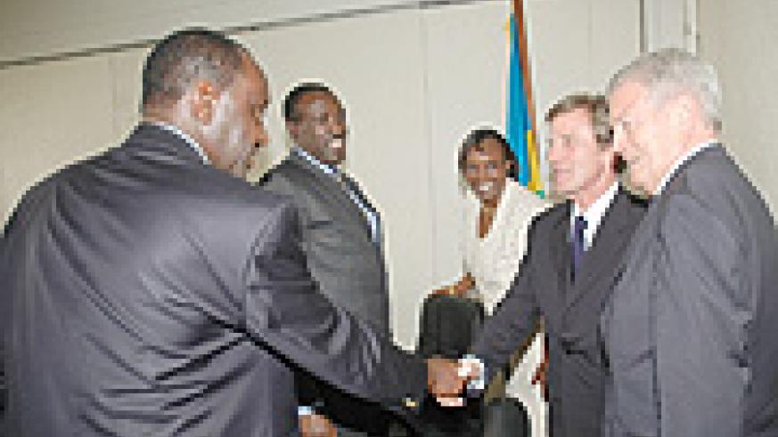 French foreign Minister Bernard Kouchner (2nd right) greets Hon.Gideon Kayinamura at Parliament. (Photo/ J. Mbanda)