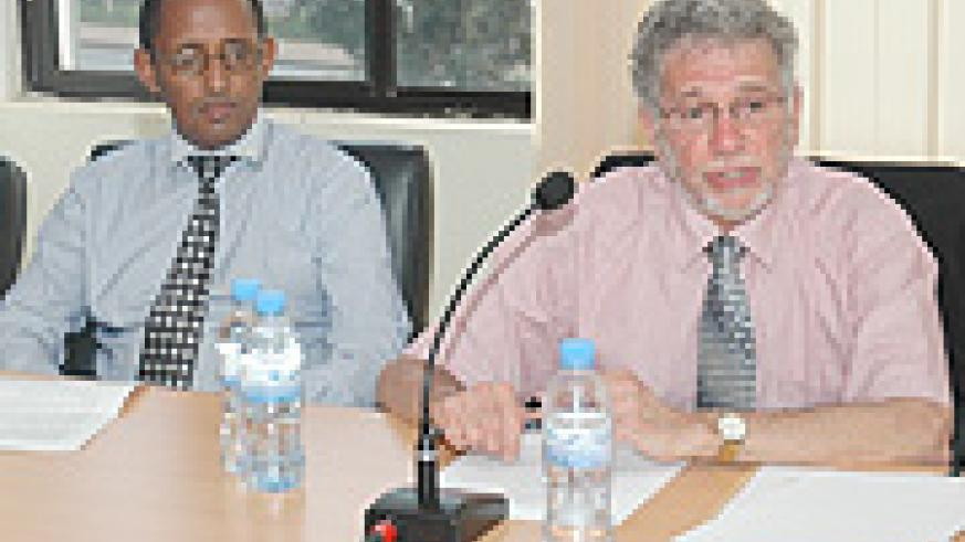 AUTHORITY: Prof Gerry Caplan (L) addressing the media yesterday. Right is CNLG's Deogene Bideri. (Photo/ F.Goodman)