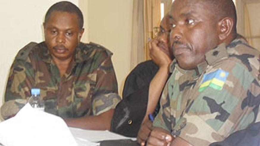THE ACCUSED; Lt. Col Paul Semana (L) and his co-accused Captain Denis Rwamo (R) during the hearing. (Photo: E. Mutara)