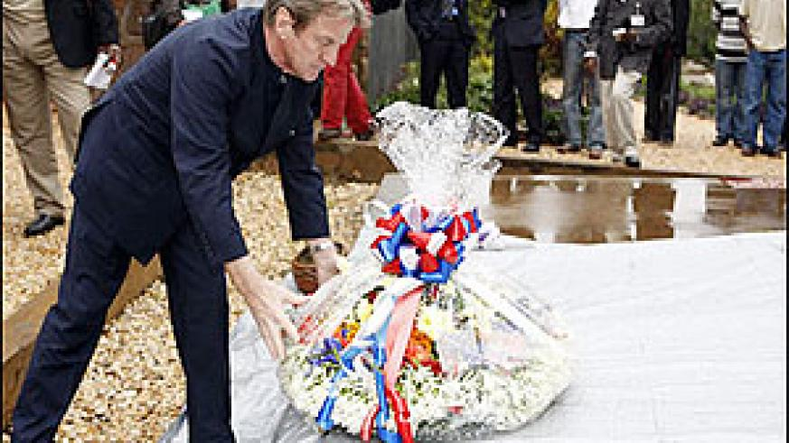 French Foreign Minister Bernard Kouchner laying a wreath on a grave in at the Gisozi Memorial. Rwandan-French relations have improve drastically