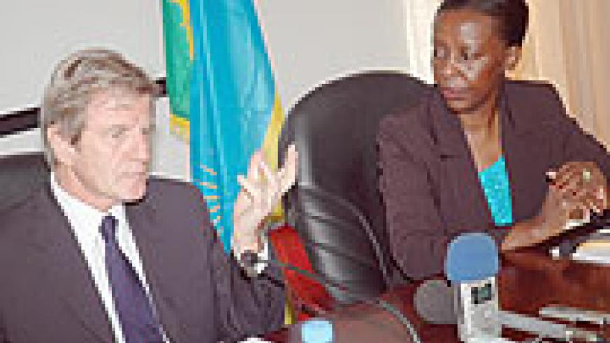 AGREED: Bernard Kouchner and Louise Mushikiwabo speaking to the media in Kigali last week.