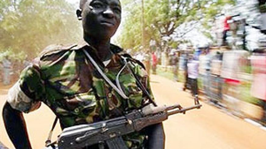 A Sudan People's Liberation Movement (SPLM) soldier keeps watch from the back of a car in Juba, southern Sudan