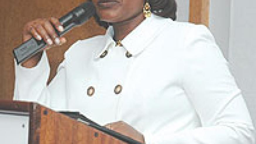 Monique Mukaruliza addressing the guests at Mille Collines on Friday evening