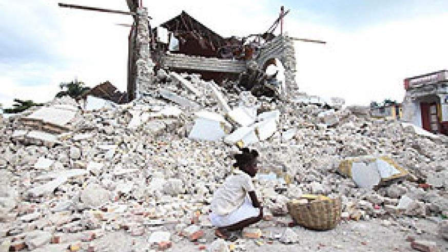 A child sitting in the ruins of her home.