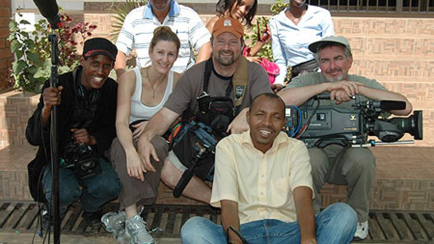 """US based """"Film Festival Rwanda"""" crew pose for a photo with some of the local film students."""