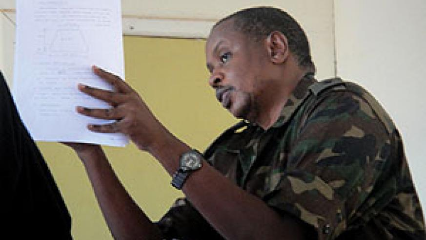 Lt. Col. Paul Semana explaining to the military tribunal yesterday the technicalities of the topography in the construction of Gashora Dyke. (Photo/ E. Mutara)