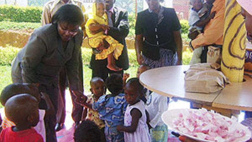 The Minister of Gender, Jeanne d;Arc Mujawamariya with some of the children yesterday