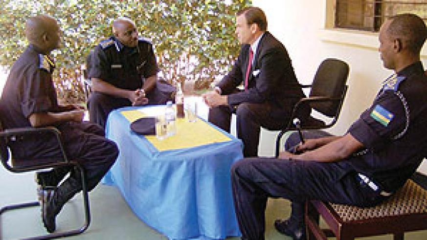 The Commissioner General of Police, Emmanuel Gasana chats with US Ambassador Stuart Symington together with senior police officers at the training school. (Photo S. Rwembeho)