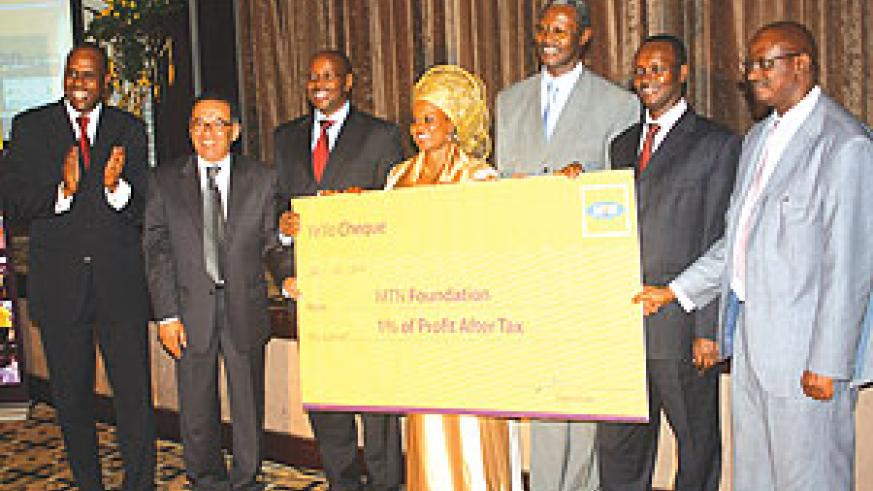 MTN Foundation board members recieve the dummy cheque at Serena on Tuesday. (Photo/ The New Times)