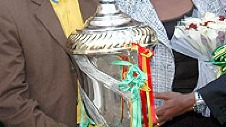 Sports minister Joseph Habineza and former minister of infrastructure Linda Bihire with the 2009 Kagame Cup. Atraco won the title after their 1-0 victory over El Merreikh.