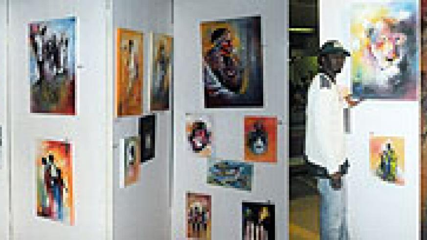 L-R : A traveller checks out the beauty of Rwandan art ; Some of the paintings on display ;Morris Munyanah shows off some of his paintings ; A painting of  Rwandan traditional dancers.