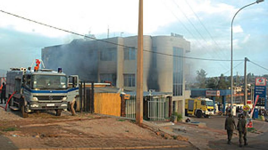 Smoke billows from the ruins of B-Club yesterday as fire-fighters try to contain it. (Photo/ F. Goodman)