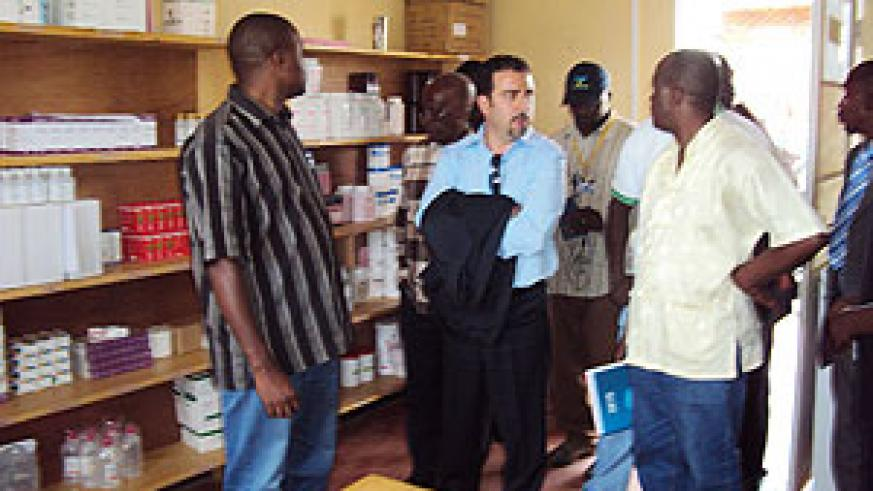 Italian cooperation country representative  Valerio Ruggirello (C), Gatsibo district Mayor, Anselme Majoro Rurangwa (R) touring Rwimbogo Health Centre