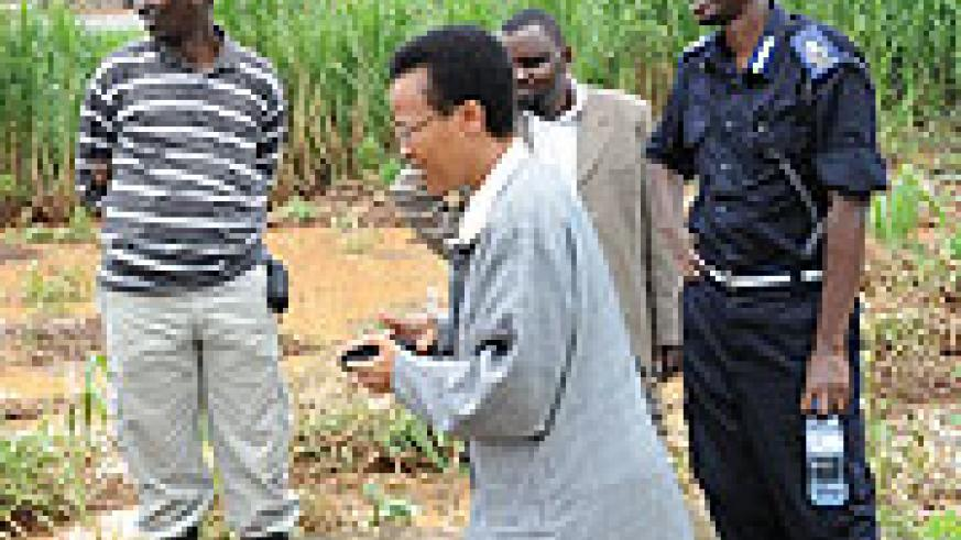 REMA boss Dr Rose Mukankomeje with security and KCC officials touring the Kacyiru wetland a day after floods devastated the area. (File Photo)
