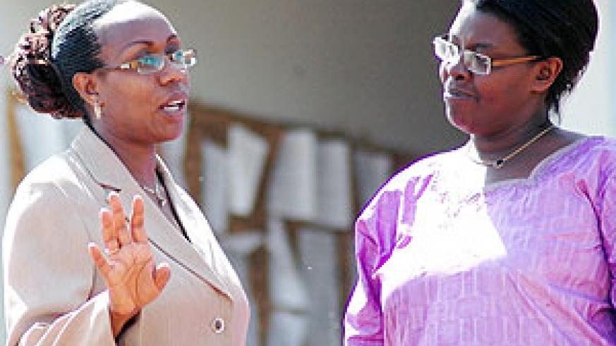 Former Gasabo Mayor Claudine Nyinawagaga (L) talking to her lawyer, Beatrice Umubyeyi, outside court yesterday. (Photo J. Mbanda)