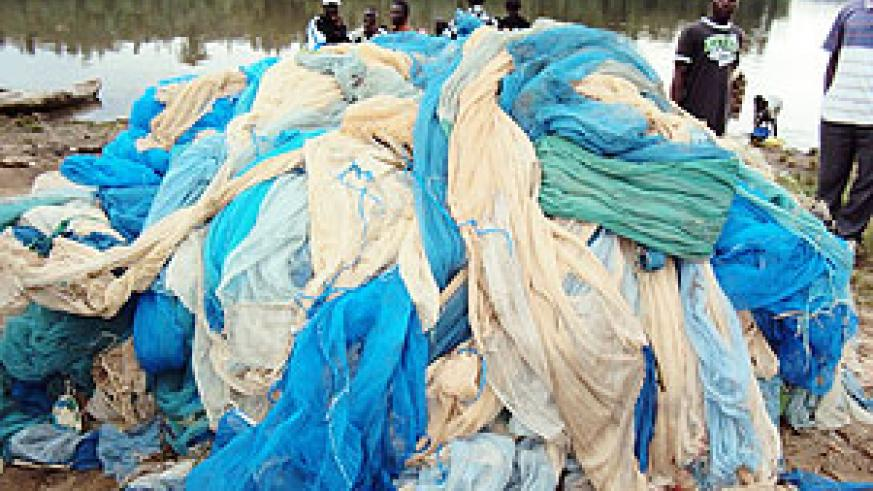 A heap of some of the illegal fishing nets before authorities set them ablaze in Kanjongo sector in Nyamasheke district. (Photo: S. Mugisha)