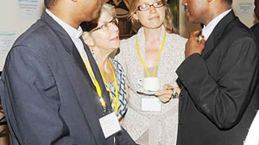 Education Minister Charles Murigande (R) talks to participants at the conference on Teachers Development and Management yesterday. (Photo J. Mbanda)
