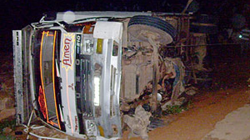 The truck overturned at Rwafandi trading centre Tuesday evening. (Photo: A. Gahene)