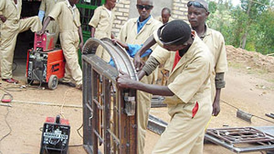 Demobilised soldiers during a practical welding session at the Nyanza Vocational training centre. (Photo: P. Ntambara)