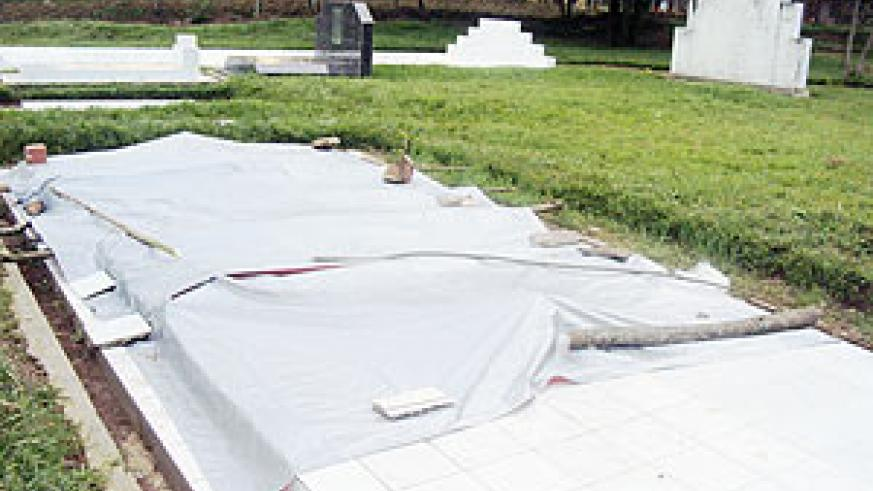 The grave is now covered by plastic tents after it collapsed. (Photo: S. Rwembeho)