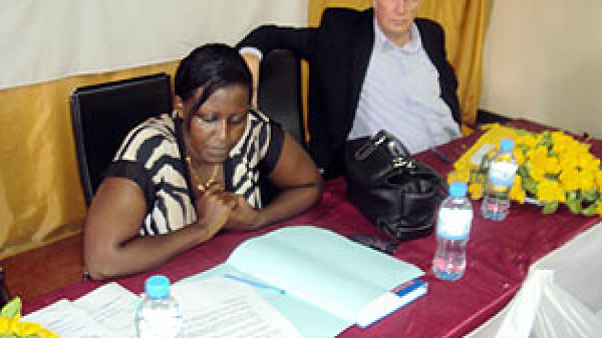 Jacqueline Bakamurera explaining to the trainees  some guidelines  as an instructor listens.(photo / S. Rwembeho)
